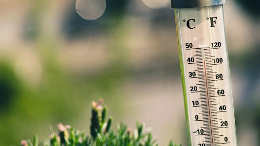 Outdoor thermometer in hot summer weather